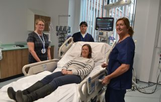 staff with new icu bed with many functions