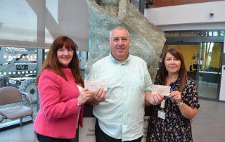 freemasons hand over charity cheque