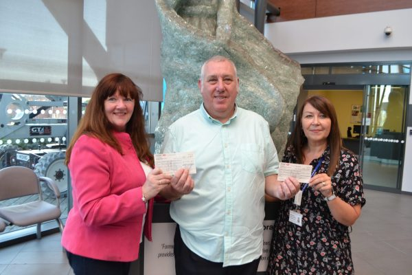 freemasons hand over charity cheque