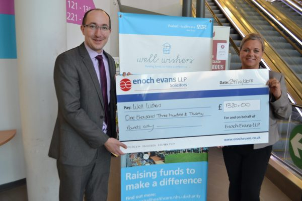 eand hands over a charity chequenoch ev