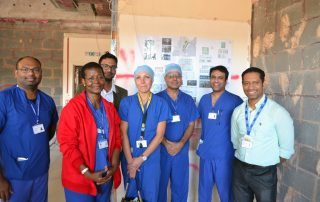 Doctors and nurses gather to see construction of the new ICU
