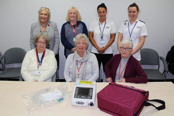 League of Friends Volunteers and Respiratory Physiotherapy Team with cough assistor