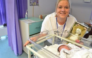 fundraising manager with firts baby born on Christmas day