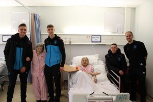 Players visiting patients on Ward 4