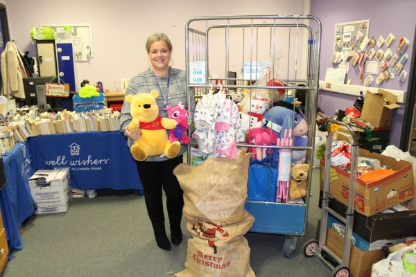 Fundraising manager with toys and gifts donated