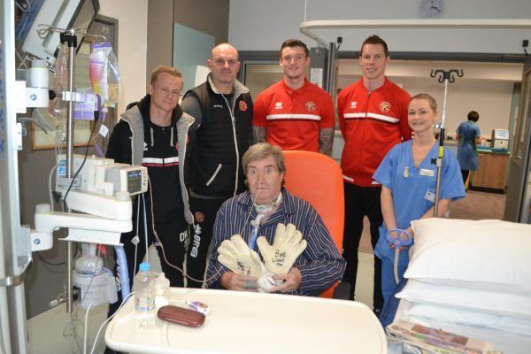 ICU patient Philip received signed goalie gloves