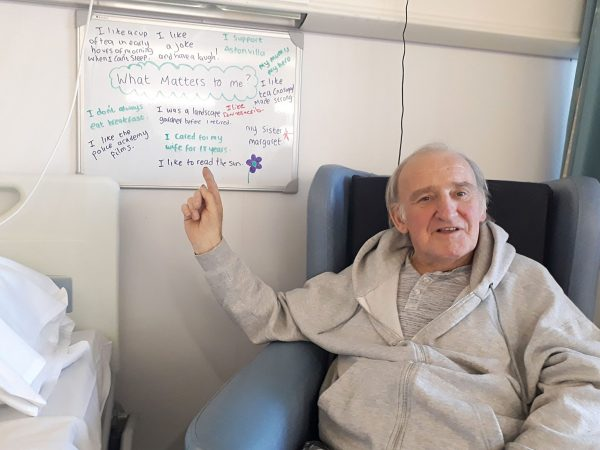Patient Derrick with What Matters To Me board