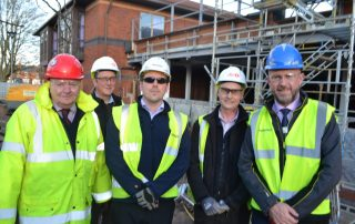 staff outside the obstetrics theatre that is being built