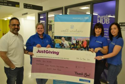 TMI hands over the charity cheque