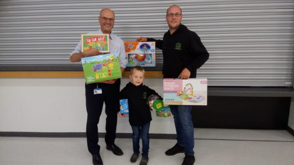 Handing over a bumper haul of toys for young patients