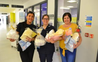 Aimee and her mum hand over items for bereaved parents