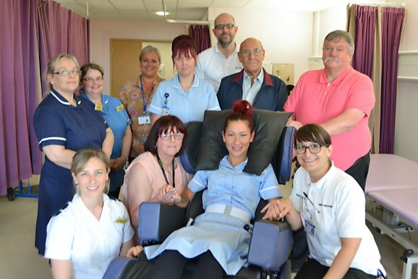 Stroke Rehab Unit staff with one of the new chairs