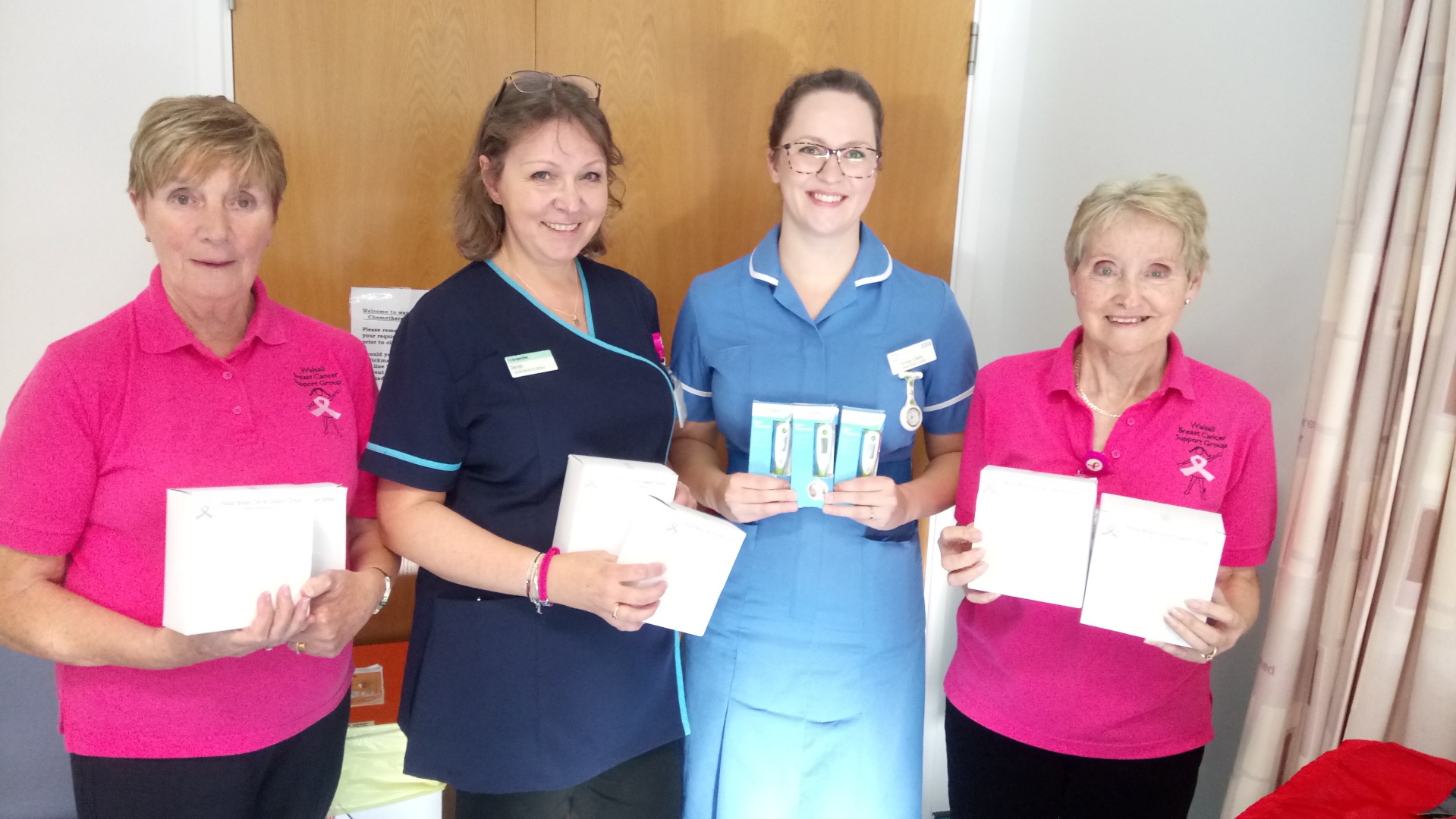 Handing over thermometers to the chemo unit