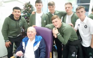 Saddlers fan John with favourite player Josh Gordon and his team mates