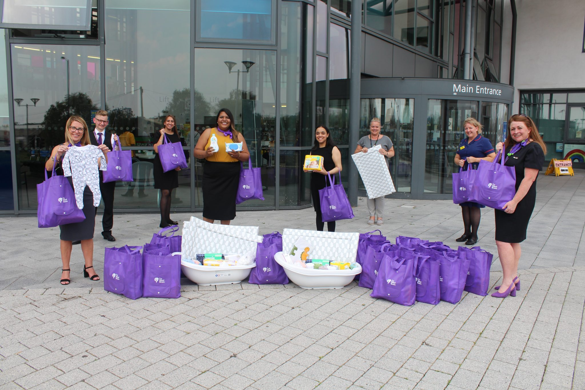 West Brom staff hand over goodie bags for new mums