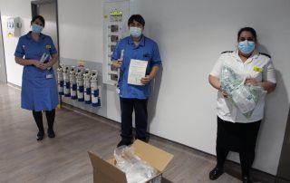 ICU staff holding swabs