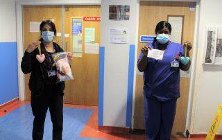 staff holding sewa donation