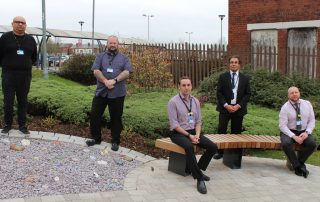 Colleagues visit the special garden created for reflection