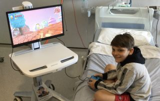 Young patient Jamie playing games