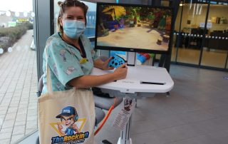 Play Specialist Jo Plank with the mobile gaming unit
