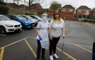 Ellie with physiotherapist Chloe, going home