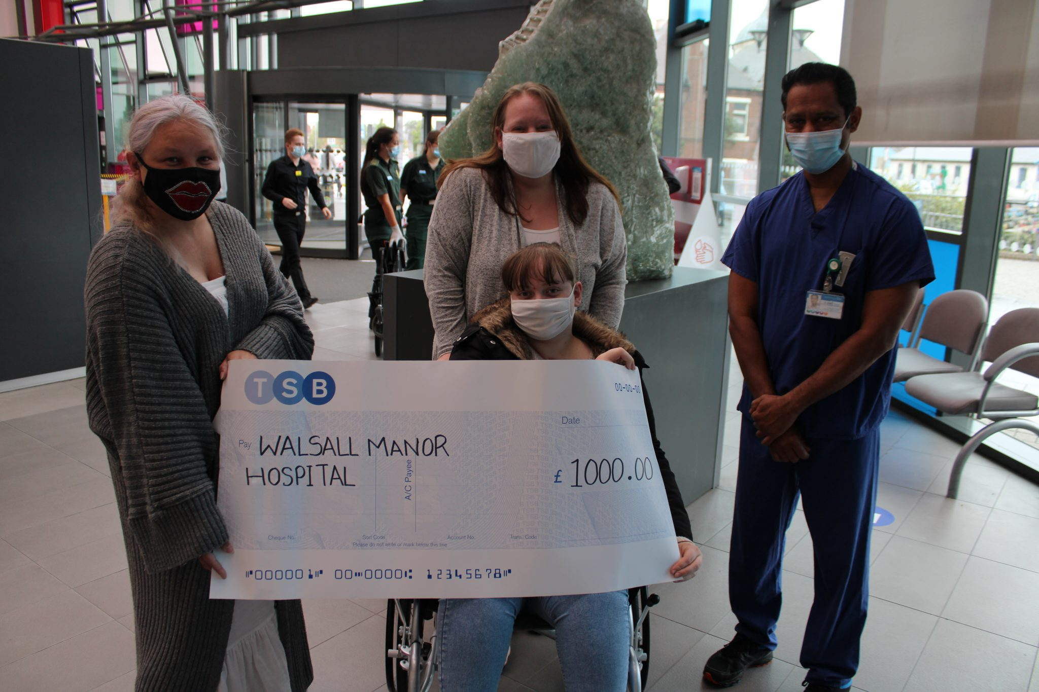 Ellie and her family have handed cheques over to the hospital